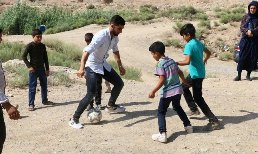 Child worker feted by iconic soccer star Jahanbakhsh